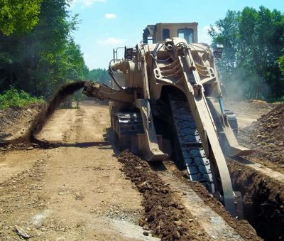 Used machinery trencher in action